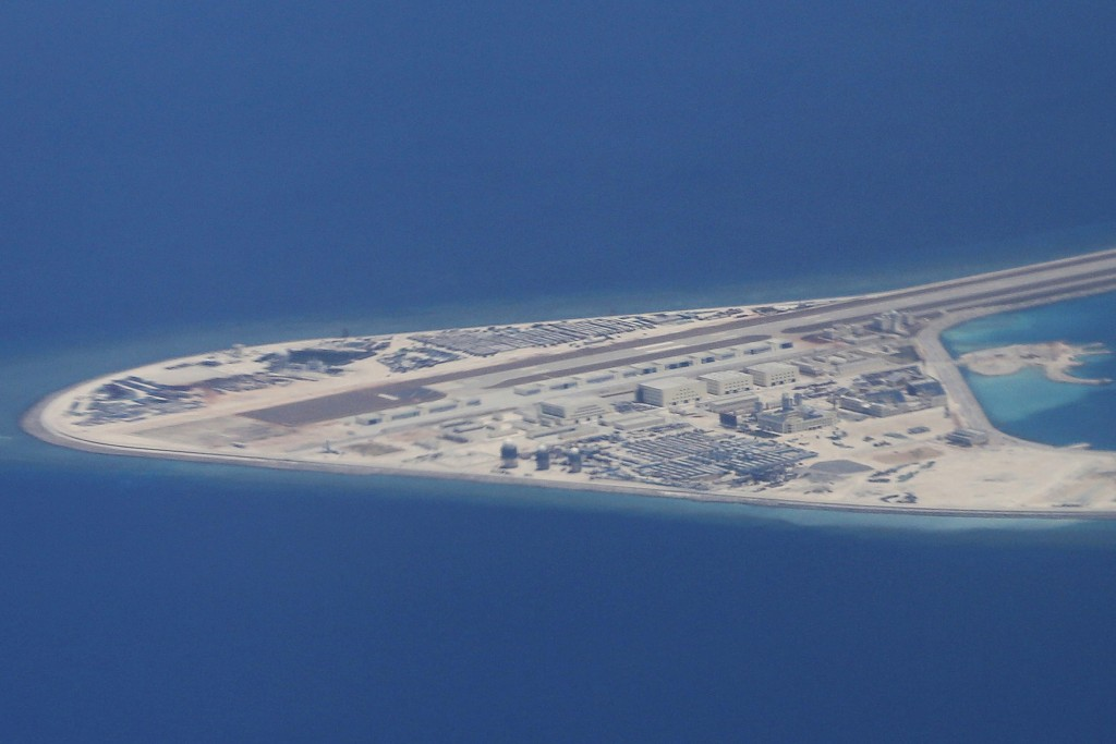 FILE - In this Friday, April 21, 2017, file photo, an airstrip, structures, and buildings on China's man-made Subi Reef in the Spratly chain of island