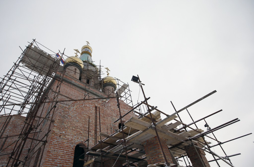 In this photo taken Friday, Jan. 11, 2019, a view of the new church under construction designed in the Russian style in the village Banstol in northwe...