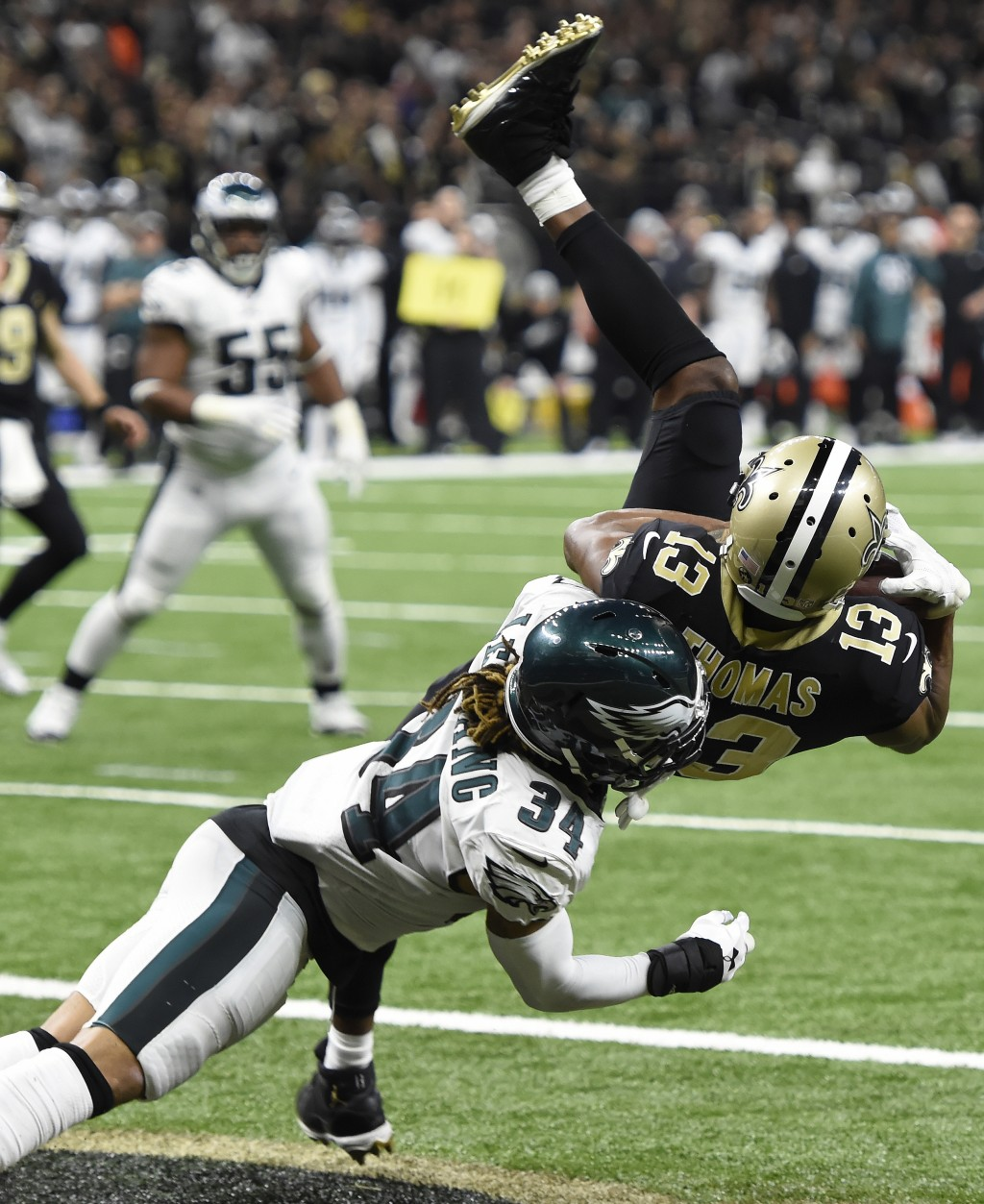 New Orleans Saints wide receiver Michael Thomas (13) pulls in a touchdown reception against Philadelphia Eagles cornerback Cre'von LeBlanc (34) in the