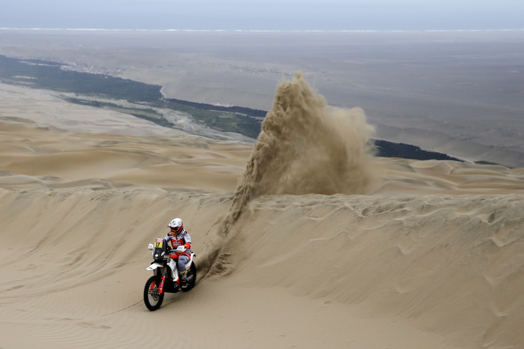 Laia Sanz of Spain rides her KTM motorbike during stage six of the Dakar Rally between Arequipa and San Juan de Marcona, Peru, Sunday, Jan. 13, 2019.