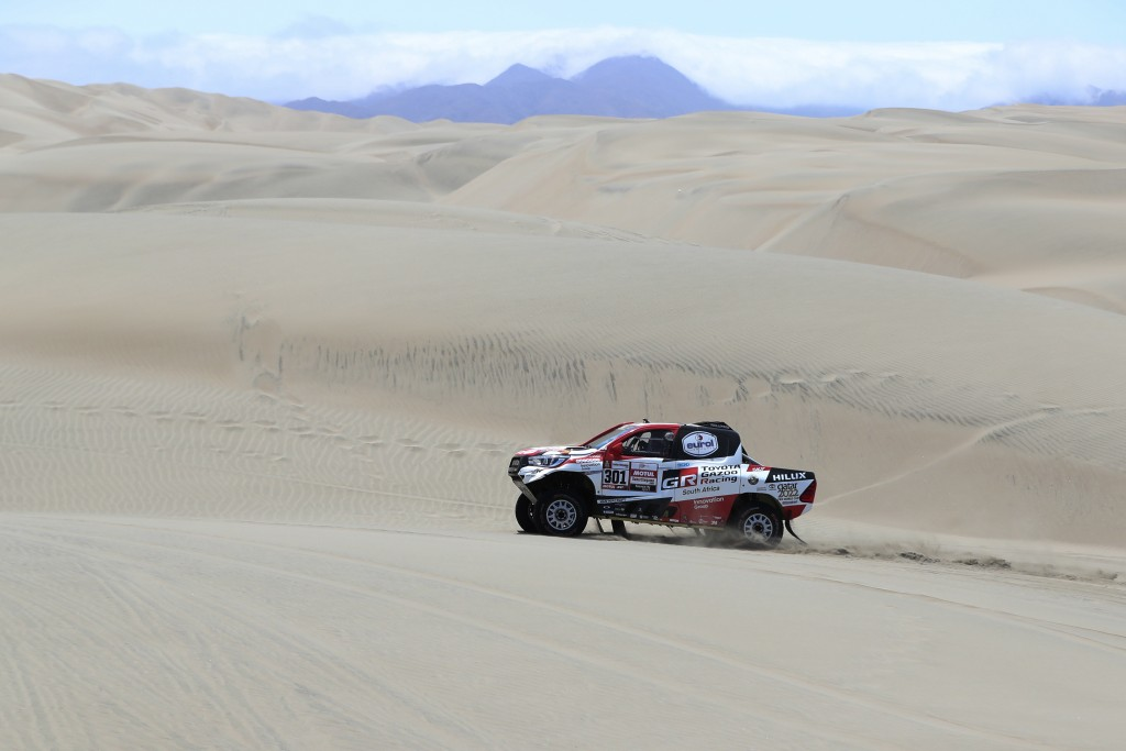 Driver Nasser Al-Attiyah, of Qatar, and co-driver Matthieu Baumel, of France, race their Toyota during the stage six of the Dakar Rally between Arequi