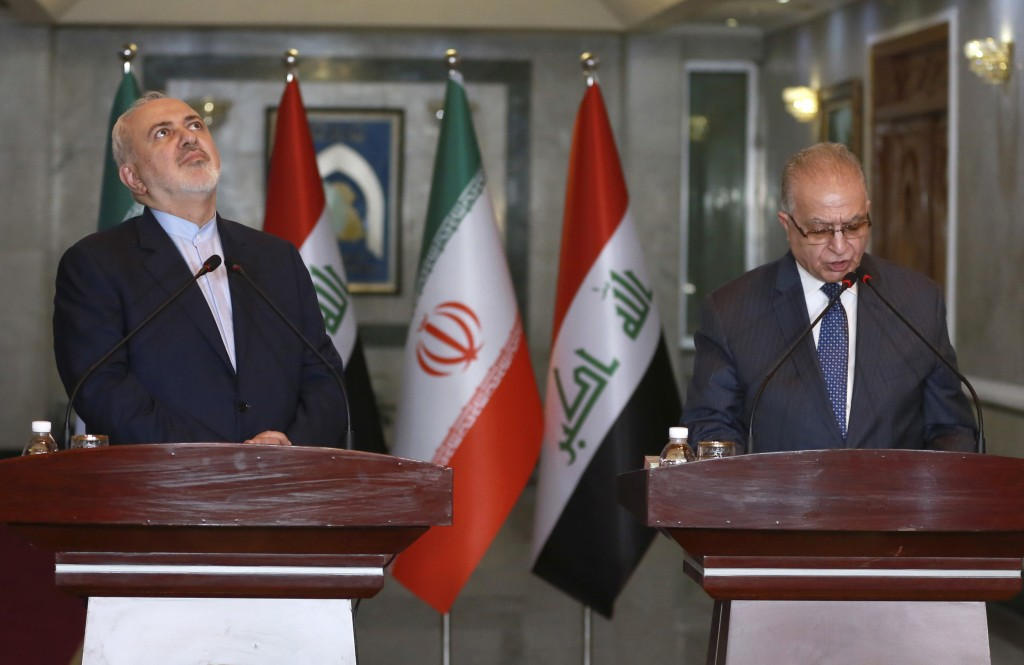 Iraqi Foreign Minister Mohammed Ali al-Hakim, right, and Iranian Foreign Minister Mohammad Javad Zarif, hold a press conference in Baghdad, Iraq, Sund