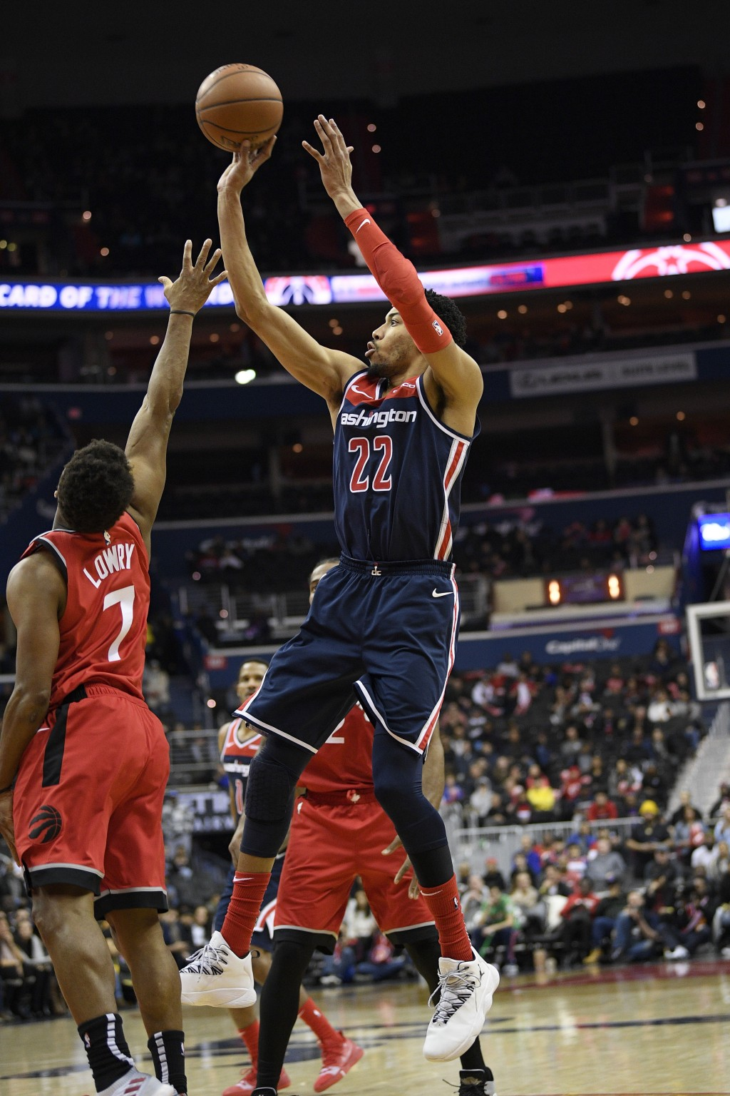 Washington Wizards forward Otto Porter Jr. (22) shoots against Toronto Raptors guard Kyle Lowry (7) during double overtime of an NBA basketball game,