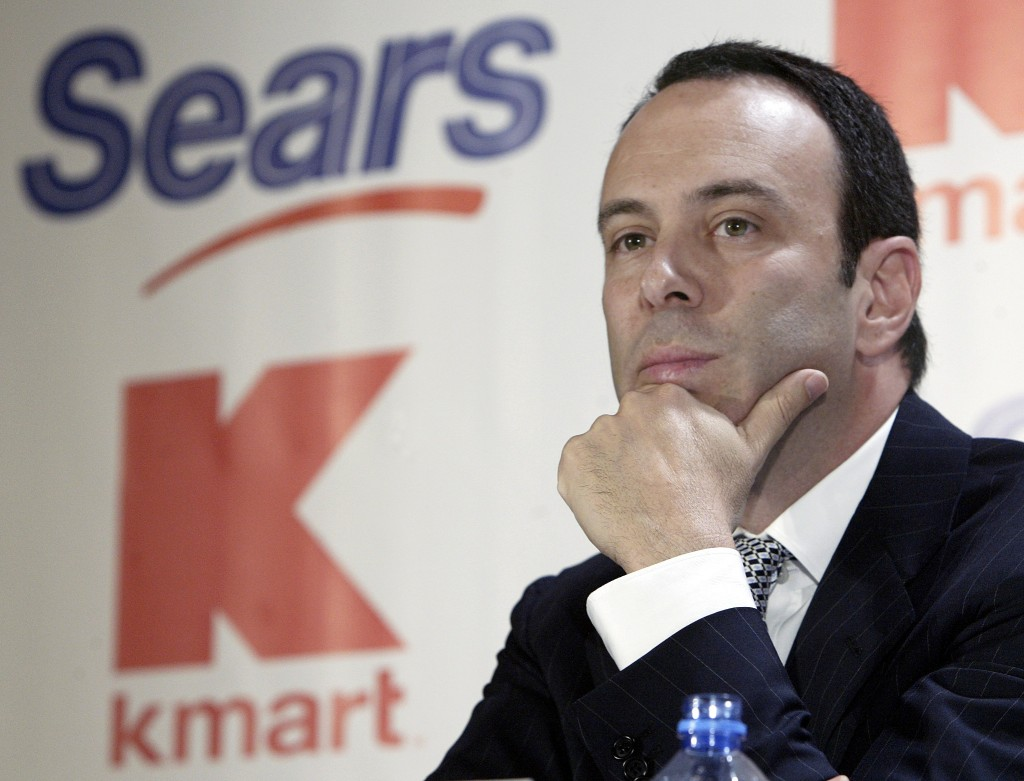 FILE- In this Nov. 17, 2004, file photo Kmart chairman Edward Lampert listens during a news conference to announce the merger of Kmart and Sears in Ne