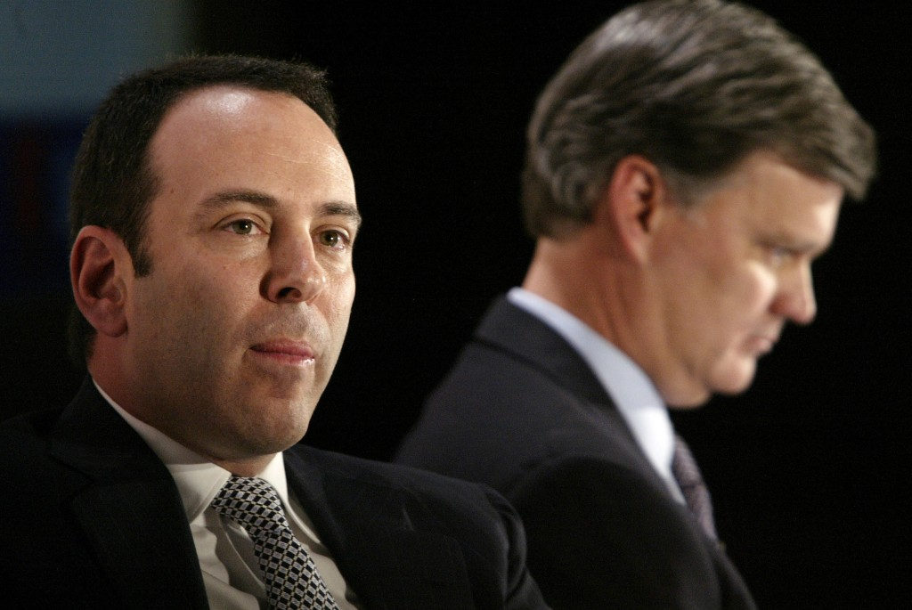 FILE- In this Nov. 17, 2004, file photo Kmart chairman Edward Lampert, left, and Sears CEO Alan Lacy listen during a news conference to announce the m