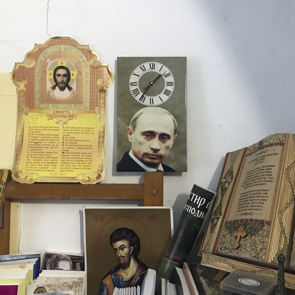 In this photo taken Friday, Jan. 11, 2019, a wall clock with a picture of the Russian President Vladimir Putin is placed in an office in the Serbian O...