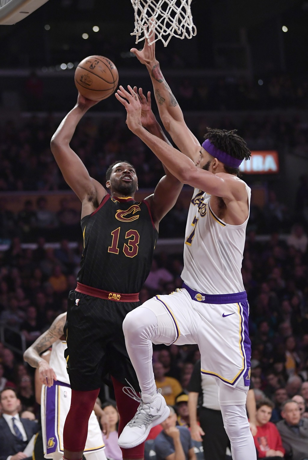 Cleveland Cavaliers center Tristan Thompson, left, shoots as Los Angeles Lakers center JaVale McGee defends during the first half of an NBA basketball