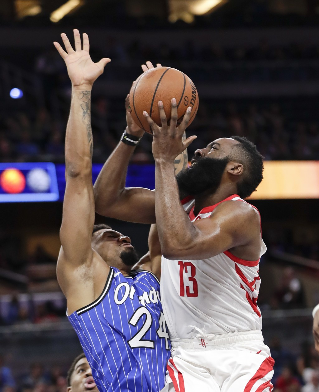 Houston Rockets' James Harden (13) goes up to shoot against Orlando Magic's Khem Birch (24) during the first half of an NBA basketball game, Sunday, J