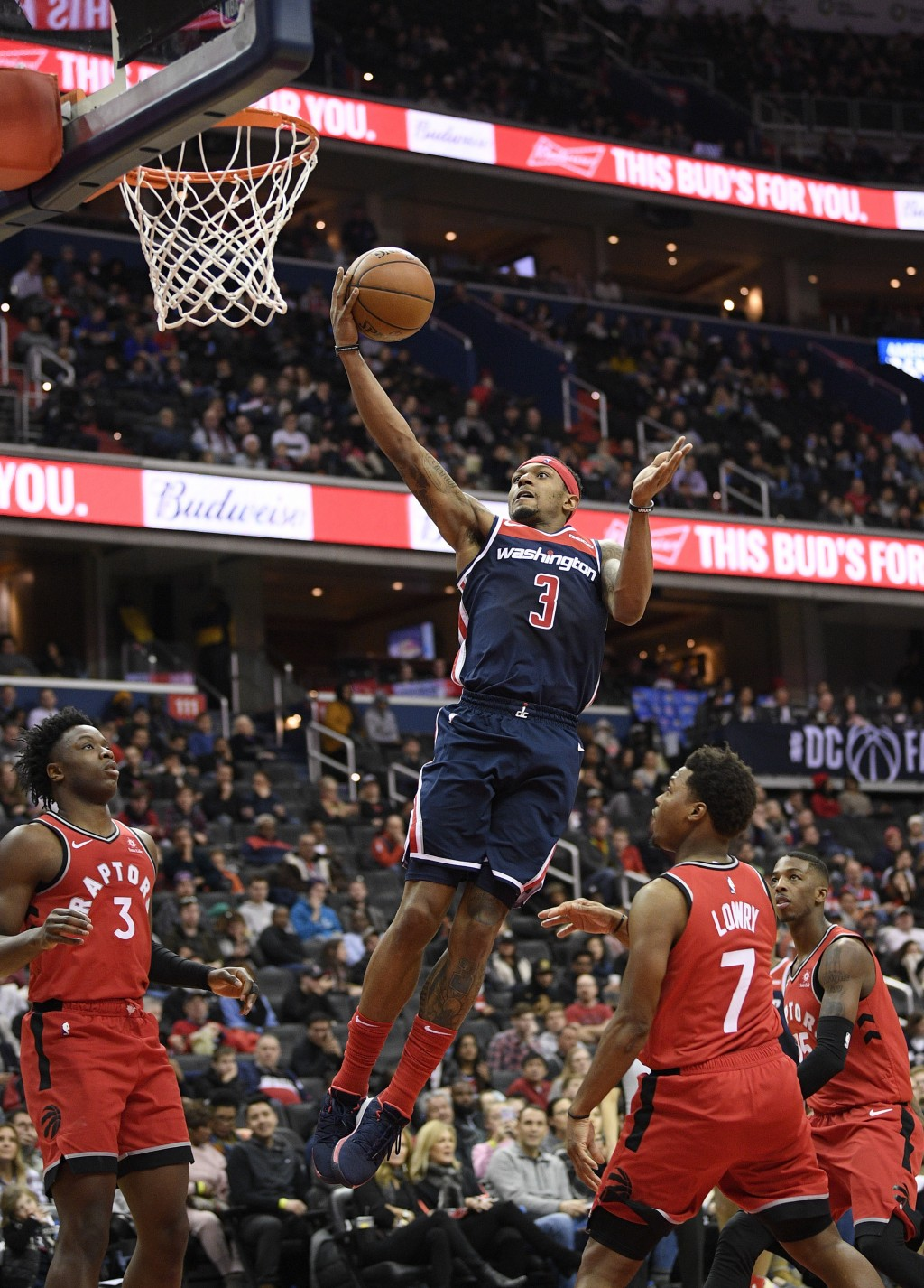 Washington Wizards guard Bradley Beal (3) goes to the basket against Toronto Raptors forward OG Anunoby (3) and guard Kyle Lowry (7) during the second
