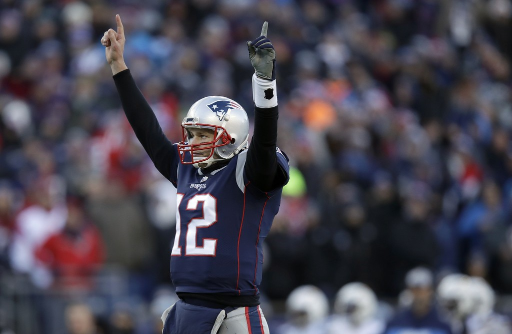 New England Patriots quarterback Tom Brady celebrates a touchdown run by running back Sony Michel during the first half of an NFL divisional playoff f...