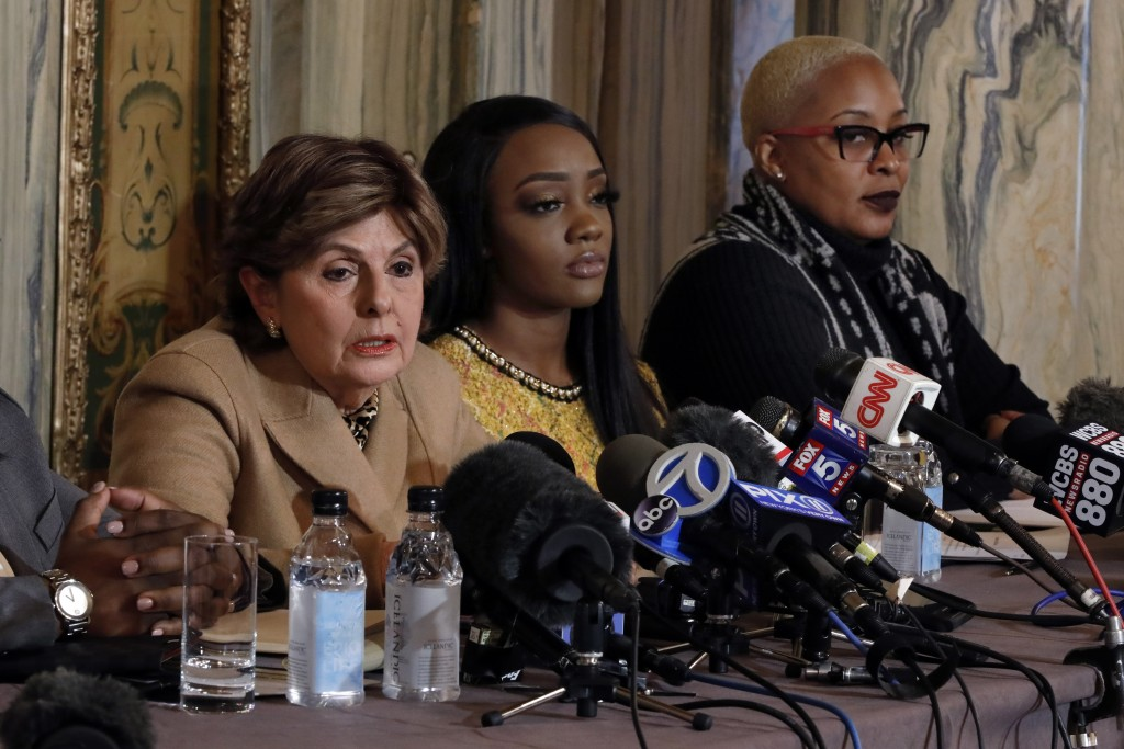 Attorney Gloria Allred, left, Faith Rodgers, center, and Michelle Kramer, mother of Dominique Gardner, participate in a news conference about R&B sing