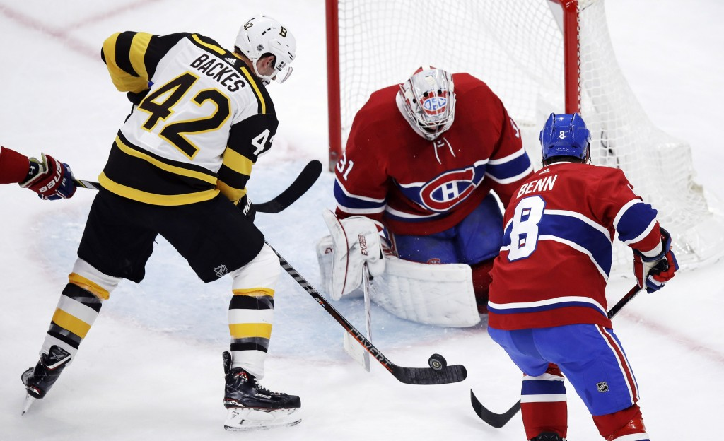 Boston Bruins right wing David Backes (42) shoots on Montreal Canadiens goaltender Carey Price, center, during the first period of an NHL hockey game ...