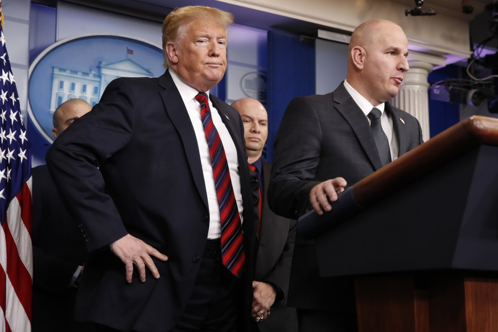 FILE - In this Jan. 3, 2019, file photo, President Donald Trump, left, listens as Brandon Judd, president of the National Border Patrol Council, talks...