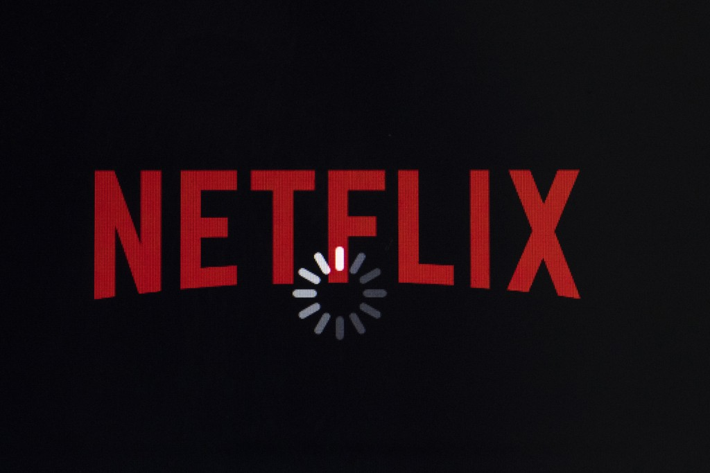 FILE- In this July 17, 2017, file photo the Netflix logo is displayed on an iPhone in Philadelphia. Netflix announce Tuesday, Jan. 15, 2019, that it i...