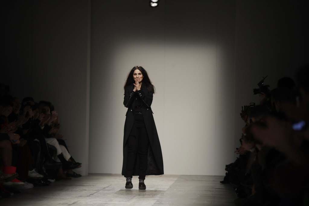 Fashion designer Isabel Benenato acknowledges the audience's applause at the end of her men's Fall-Winter 2019-20 fashion show, that was presented in