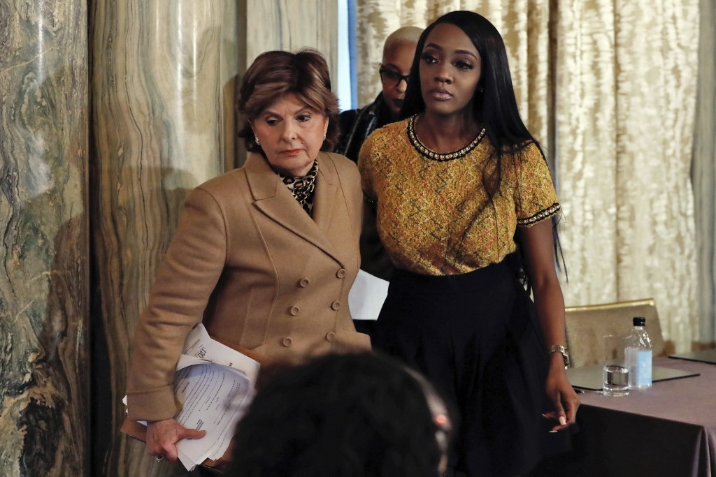 Attorney Gloria Allred, left escorts Faith Rogers after a news conference about R&B singer R. Kelly in New York, Monday, Jan. 14, 2019. Kelly has been