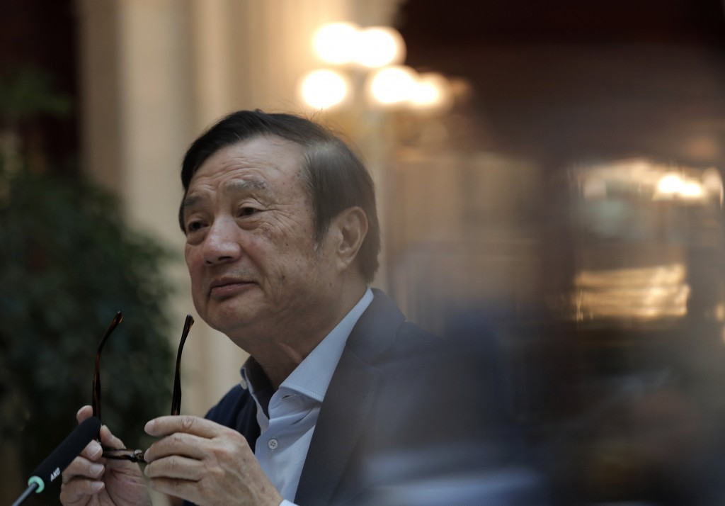 Ren Zhengfei, founder and CEO of Huawei, takes off his glasses during a round table meeting with the media in Shenzhen city, south China's Guangdong p