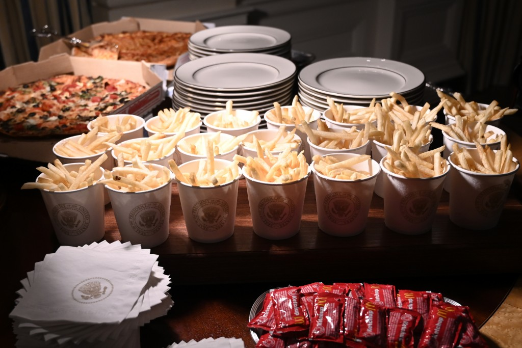 In this Jan. 14, 2019 photo, french fries and pizza are some of the fast food items for the reception for the Clemson Tigers in the State Dining Room