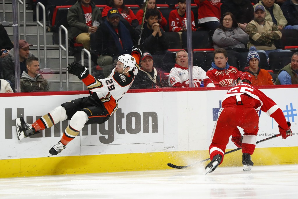 Anaheim Ducks center Devin Shore (29) is sent into the air by Detroit Red Wings defenseman Niklas Kronwall (55) in the third period of an NHL hockey g...