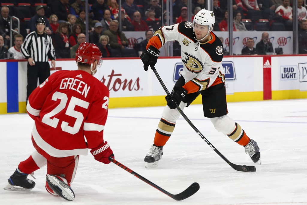 Detroit Red Wings defenseman Mike Green (25) readies to block a shot by Anaheim Ducks left wing Nick Ritchie (37) in the first period of an NHL hockey...
