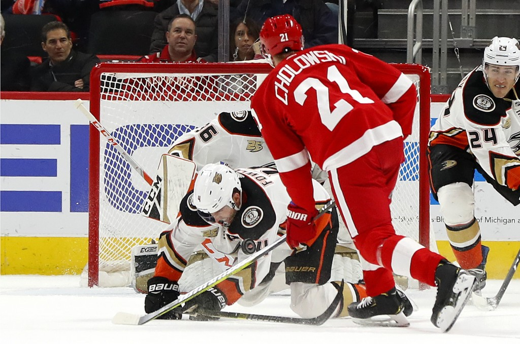 Anaheim Ducks defenseman Cam Fowler (4) blocks a shot by Detroit Red Wings defenseman Dennis Cholowski (21) in the first period of an NHL hockey game,