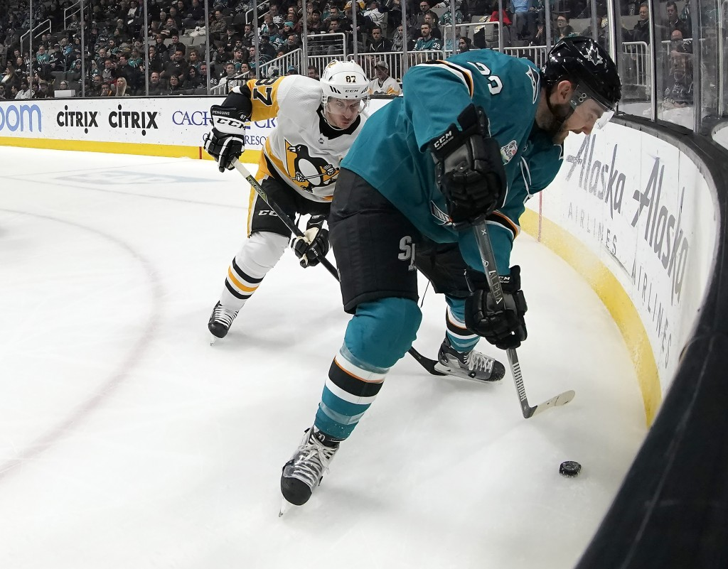 San Jose Sharks right wing Barclay Goodrow (23) battles for the puck against Pittsburgh Penguins center Sidney Crosby (87) during the first period of