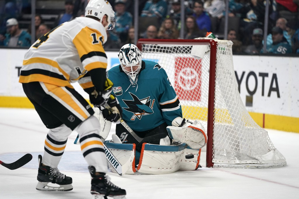 San Jose Sharks goaltender Martin Jones (31) defends on a shot from Pittsburgh Penguins left wing Tanner Pearson (14) during the second period of an N