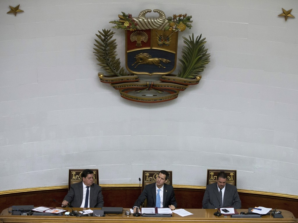 FILE - In this Jan. 15, 2019 file photo, leaders of the opposition-controlled National Assembly, President Juan Guaido, center, First Vice President E