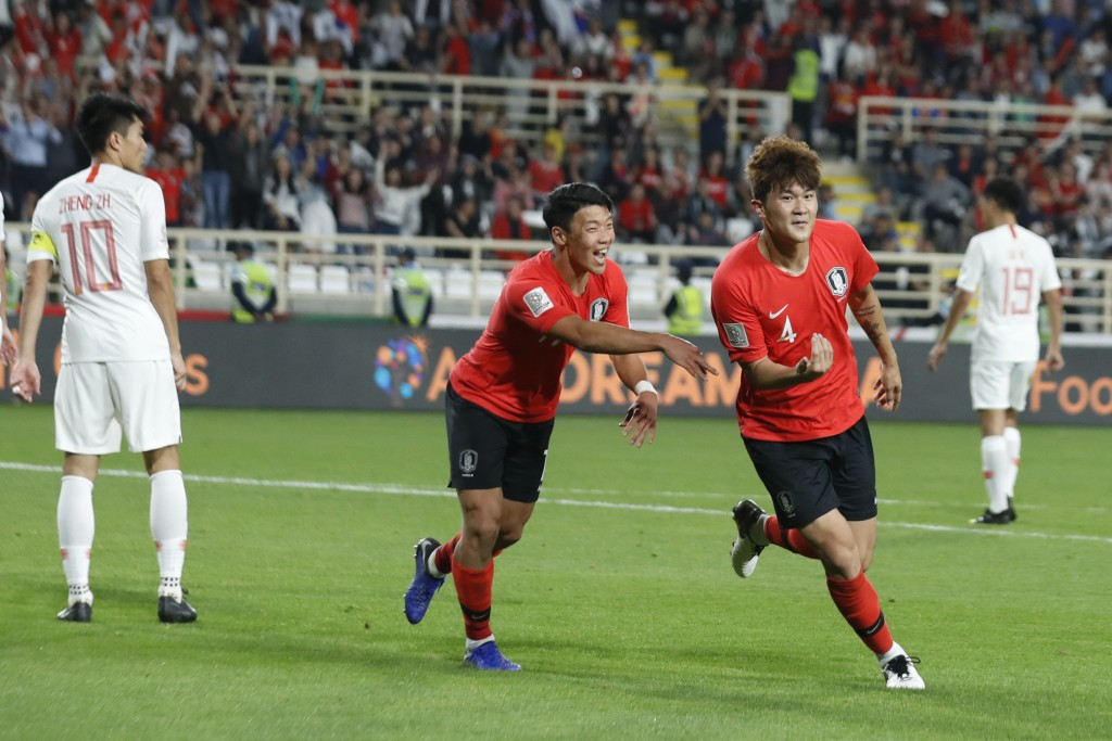 South Korea's defender Kim Min-Jae celebrates with his teammates after scoring his team's second goal during the AFC Asian Cup group C soccer match be