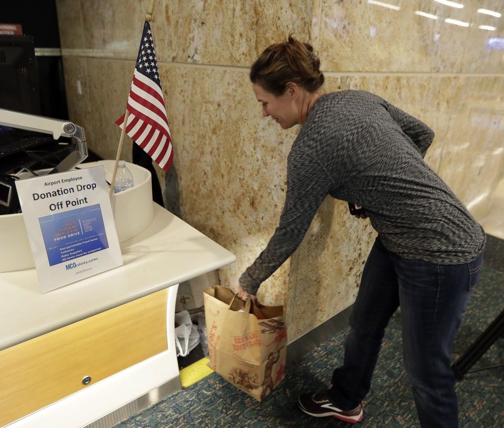 Emily Hunt, a flight attendant for Southwest Airlines, drops off a donation of food for TSA workers at Orlando International Airport Tuesday, Jan. 15,