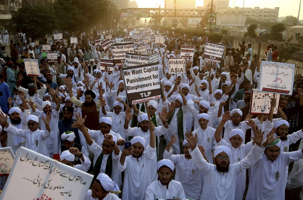 FILE - In this Nov. 21, 2018 file photo, Pakistani religious students rally for the implementation of a blasphemy law and against the acquittal of Aas