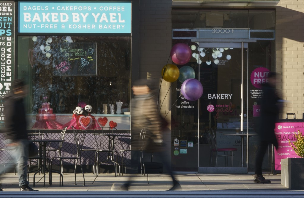 In this Friday, Jan. 11, 2019, photo people walk past the Baked by Yael bakery in Washington. The bakery is located across from Smithsonian's National...