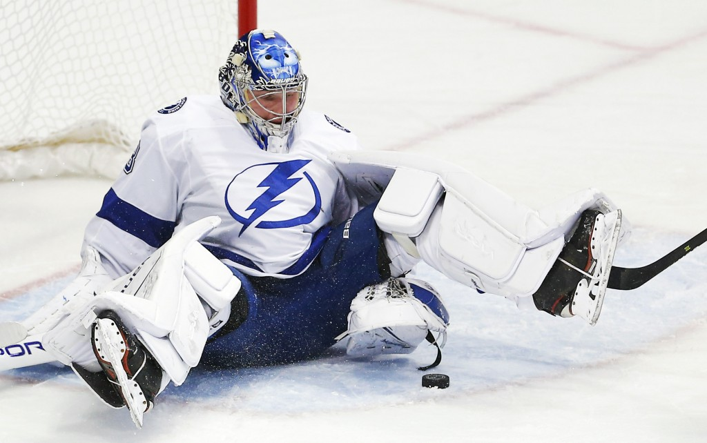Tampa Bay Lightning goaltender Andrei Vasilevskiy (88) stops a shot during the first period of an NHL hockey game against the Dallas Stars, Tuesday, J...
