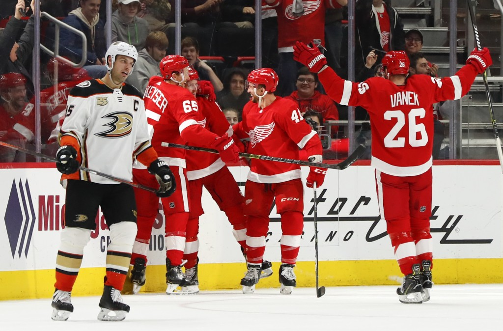 Detroit Red Wings right wing Gustav Nyquist celebrates his goal as Anaheim Ducks center Ryan Getzlaf (15) skates to the bench in the third period of a...