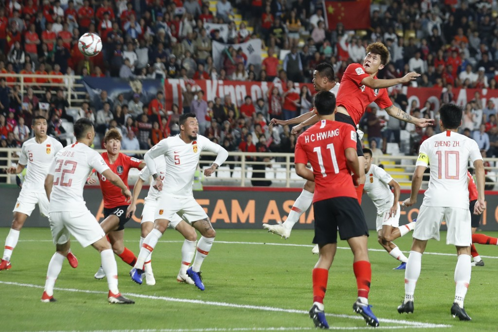 South Korea's defender Kim Min-Jae scores his team's second goal during the AFC Asian Cup group C soccer match between South Korea and China at Al Nah