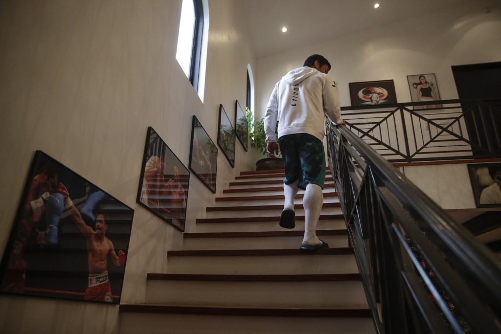 Boxer Manny Pacquiao walks up the steps to his bedroom for a nap following his morning run Monday, Jan. 14, 2019, in Los Angeles. The Filipino legend