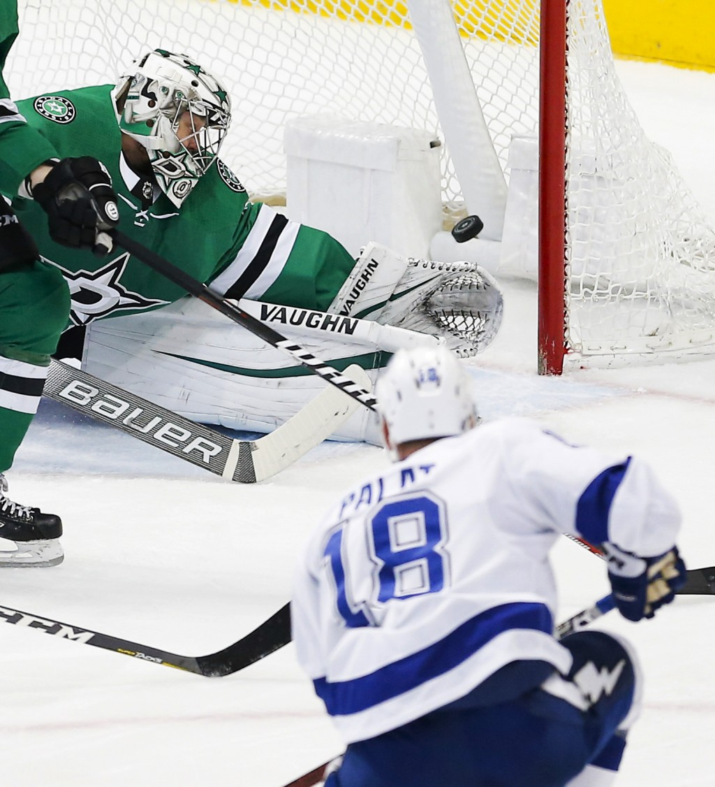 Dallas Stars goaltender Anton Khudobin (35) is unable to stop a shot by Tampa Bay Lightning forward Ondrej Palat (18) during the first period of an NH...