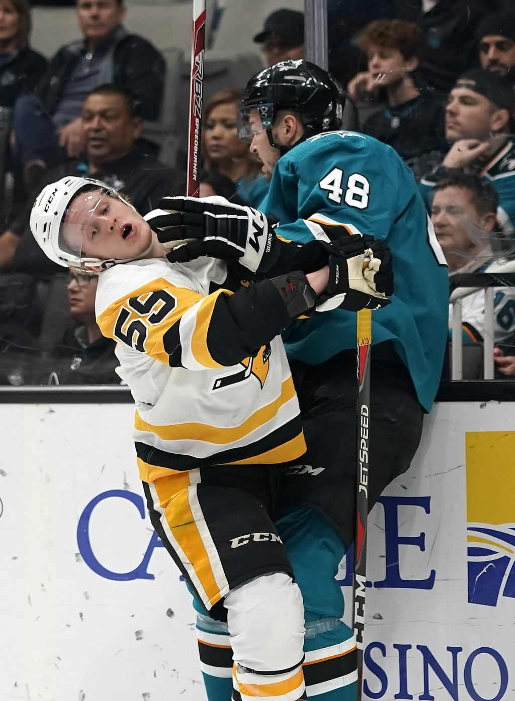 San Jose Sharks center Tomas Hertl (48) is checked into the boards by Pittsburgh Penguins left wing Jake Guentzel (59) during the first period of an N