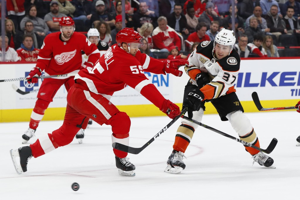 Anaheim Ducks left wing Nick Ritchie (37) shoots past Detroit Red Wings defenseman Niklas Kronwall (55) in the first period of an NHL hockey game, Tue...