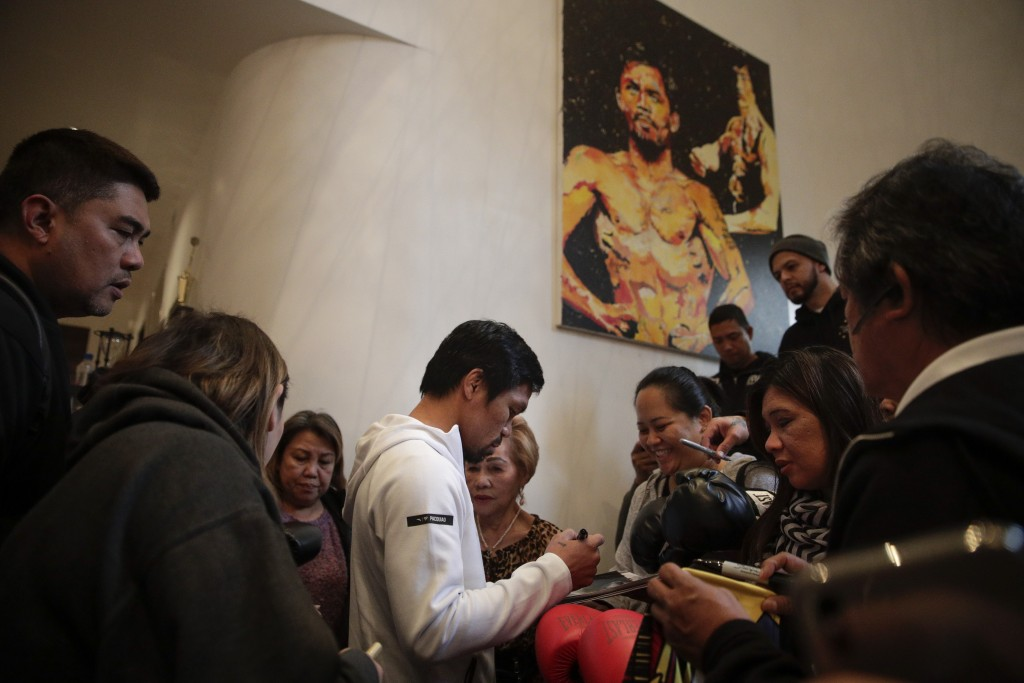 Boxer Manny Pacquiao is surrounded by guests at his home Monday, Jan. 14, 2019, in Los Angeles. The Filipino legend is in the winter of his career, ge...