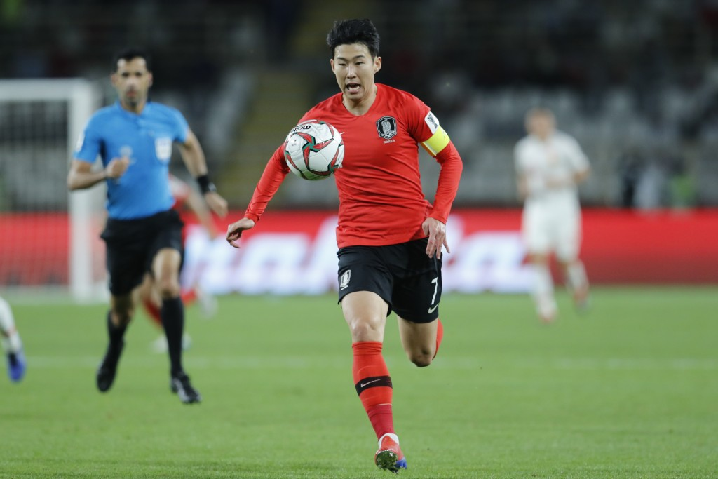 South Korea's forward Son Heung-Min runs with the ball during the AFC Asian Cup group C soccer match between South Korea and China at Al Nahyan Stadiu