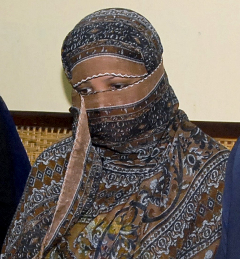 FILE - In this Nov. 20, 2010, file photo, Aasia Bibi, a Pakistani Christian woman, listens to officials at a prison in Sheikhupura near Lahore, Pakist