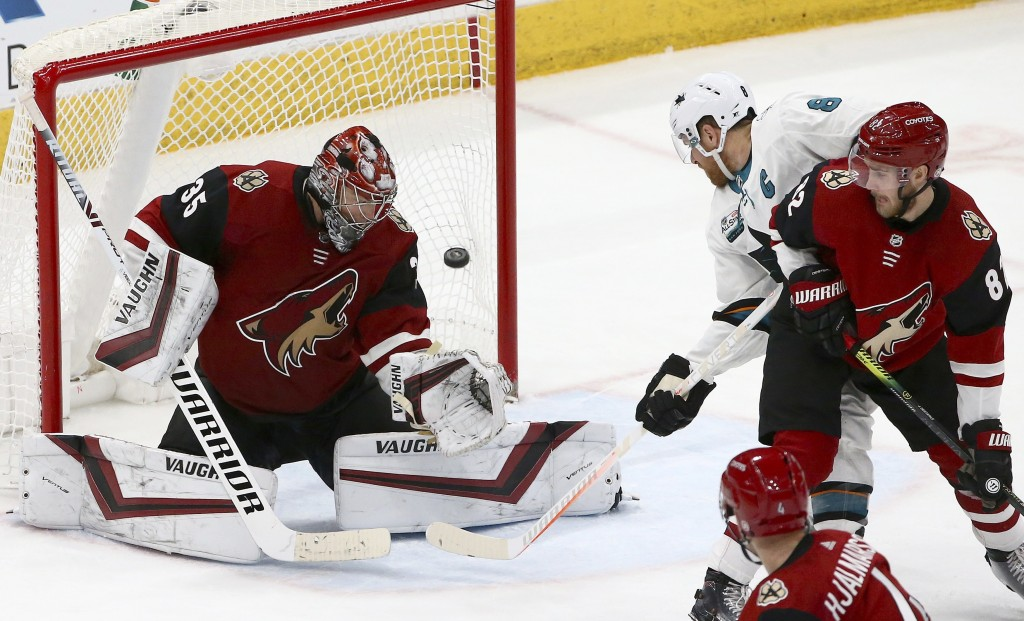 Arizona Coyotes goaltender Darcy Kuemper (35) gives up a goal to San Jose Sharks' Logan Couture, not seen, as Sharks center Joe Pavelski (8) and Coyot