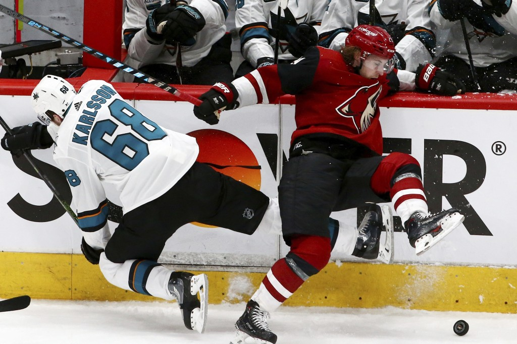 San Jose Sharks center Melker Karlsson (68) and Arizona Coyotes right wing Mario Kempe, right, collide along the boards during the third period of an