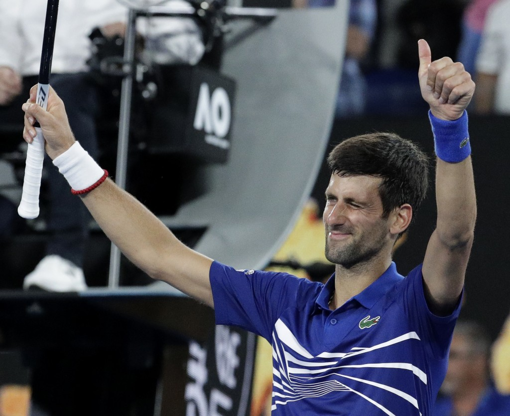 Serbia's Novak Djokovic celebrates after defeating France's Jo-Wilfried Tsonga during their second round match at the Australian Open tennis champions