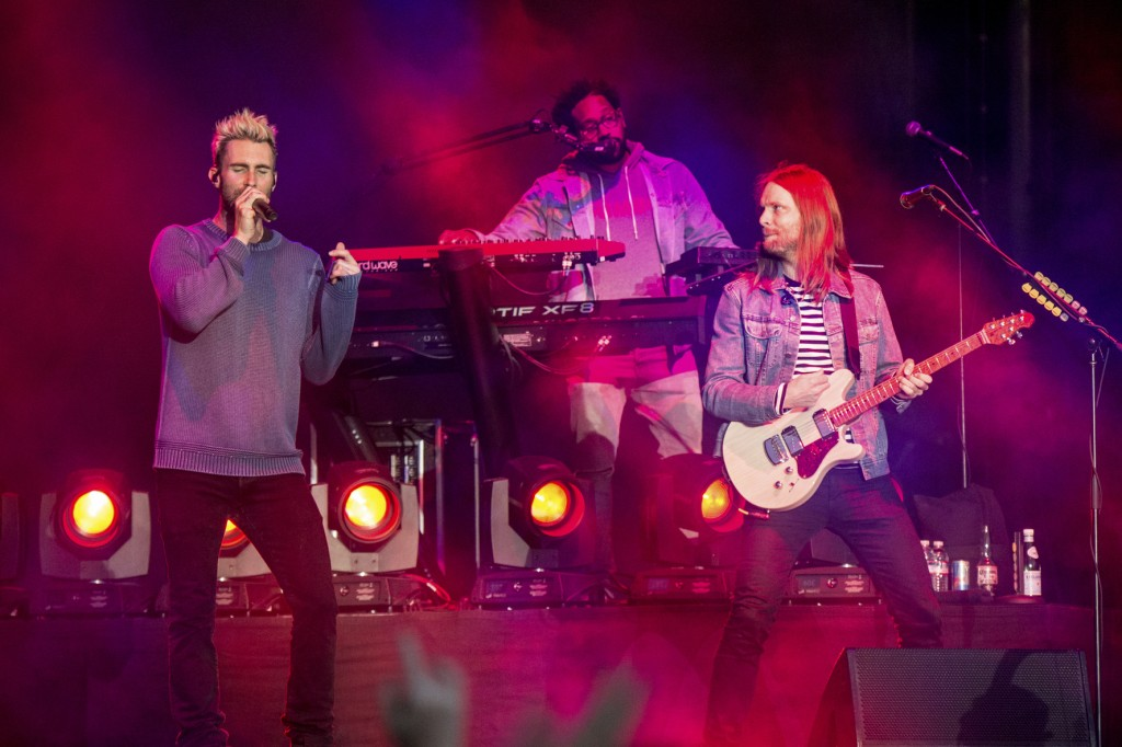 FILe - In this May 26, 2017 file photo, Adam Levine, from left, PJ Morton and James Valentine of Maroon 5 perform at BottleRock Napa Valley Music Fest