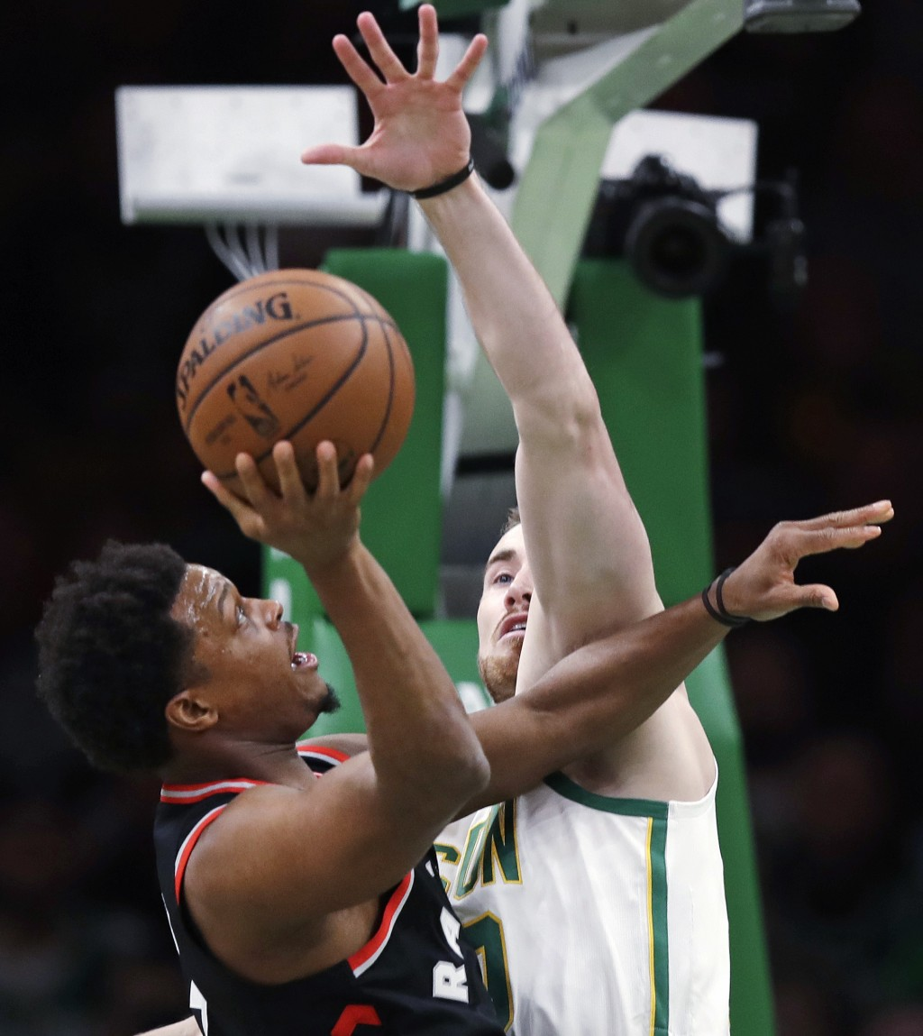 Boston Celtics forward Gordon Hayward, right, defends against Toronto Raptors guard Kyle Lowry during the first quarter of an NBA basketball game in B