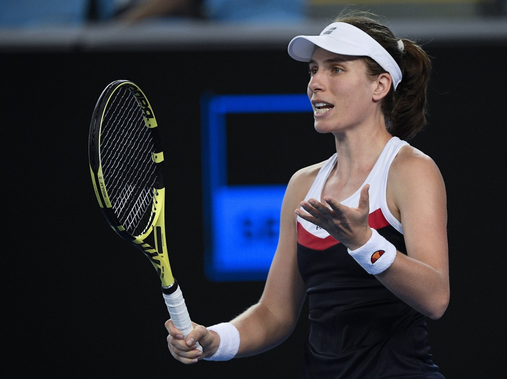 Britain's Johanna Konta reacts during her second round match against Spain's Garbine Muguruza at the Australian Open tennis championships in Melbourne