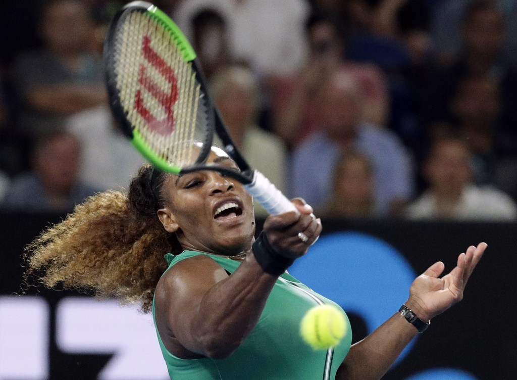 United States' Serena Williams hits a forehand return to Canada's Eugenie Bouchard during their second round match at the Australian Open tennis champ...