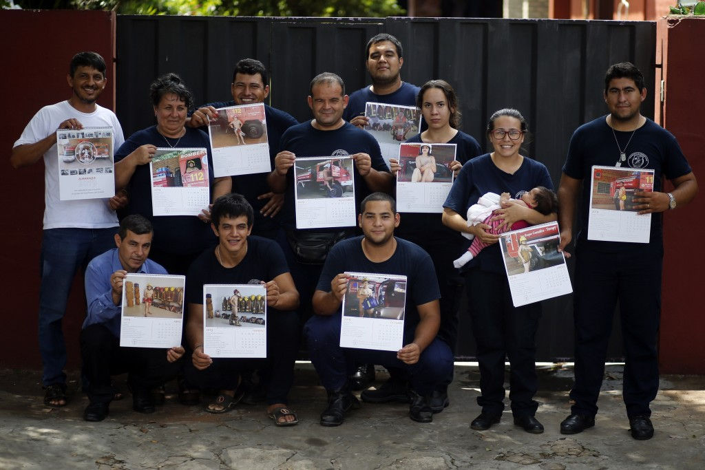 In this Jan. 12, 2019 photo, the firefighters of San Roque Gonzalez pose for a group photo before going out in the streets to sell calendars, in Asunc